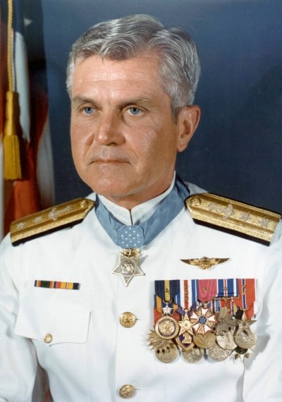 050706-N-0000X-005 U.S. Navy File Photo: Formal portrait of Rear Adm. James B. Stockdale in dress white uniform. He is one of the most highly decorated officers in the history of the Nay, wearing twenty six personal combat decorations, including two Distinguished Flying Crosses, three Distinguished Service Medals, two Purple Hearts, and four Silver Star medals in addition to the Medal of Honor. Later he obtained the rank of Vice Admiral, and is the only three star Admiral in the history of the Navy to wear both aviator wings and the Medal of Honor. U.S. Navy photo (RELEASED)