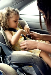mother-in-the-process-of-securing-her-young-daughter-into-her-back-seat-located-child-safety-seat-374x544